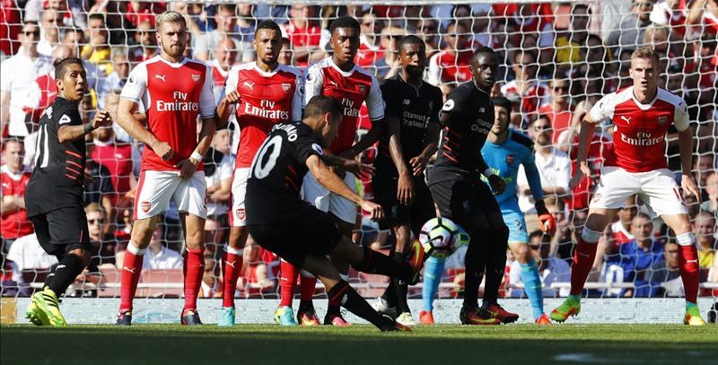 Coutinho scores the equalising goal in a 4-3 win against Arsenal at The Emirates Stadium.