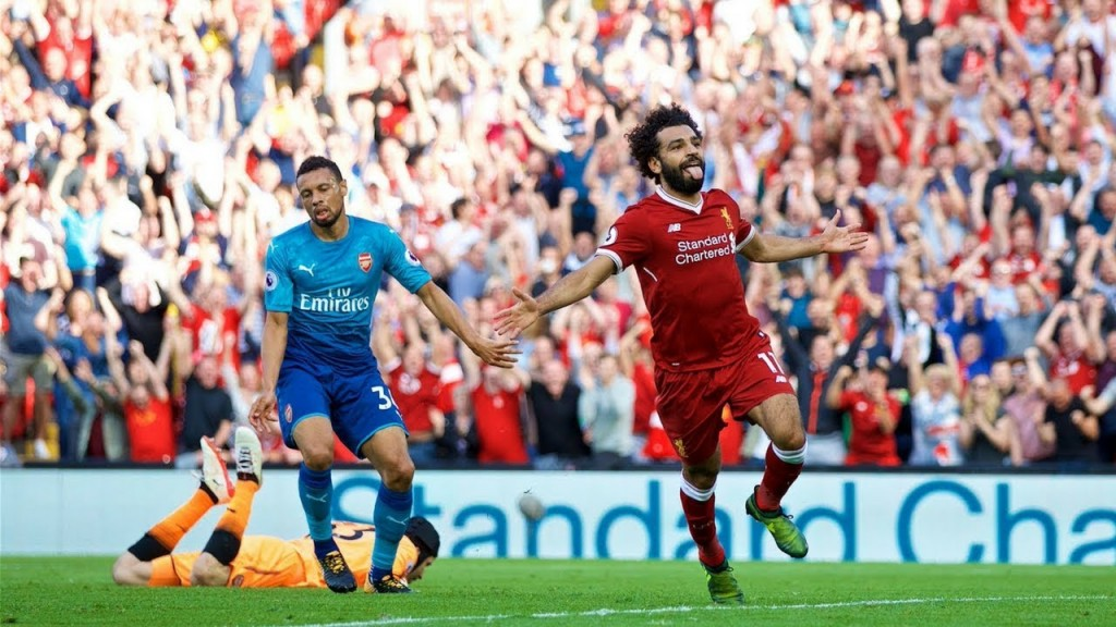 Salah wheels away in celebration as he scored the 3rd goal in a 4-0 win over Arsenal at Anfield.